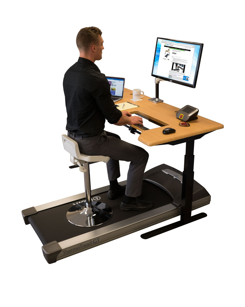 Tempo TreadTop™ Sit-Stand Stool on a treadmill
