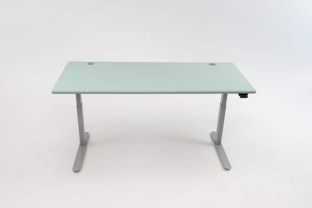 A Luxe Sage desktop on a silver base.