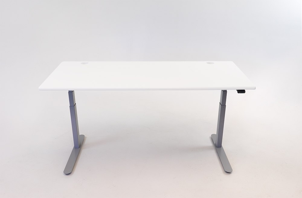 A Designer White desktop on a silver base.