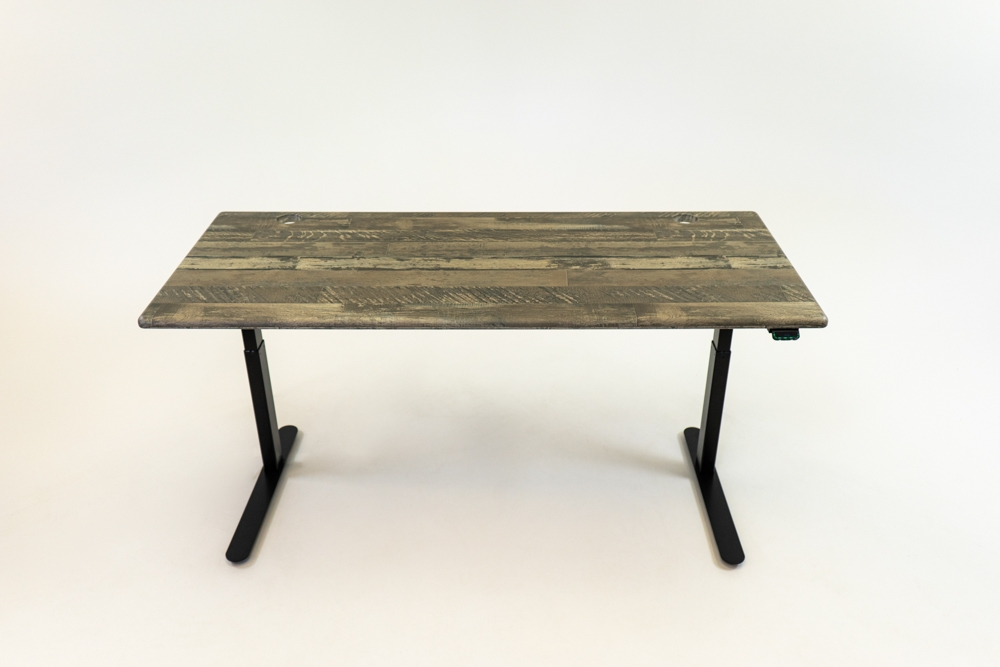 A Reclaimed Warehouse Oak desktop on a black base.