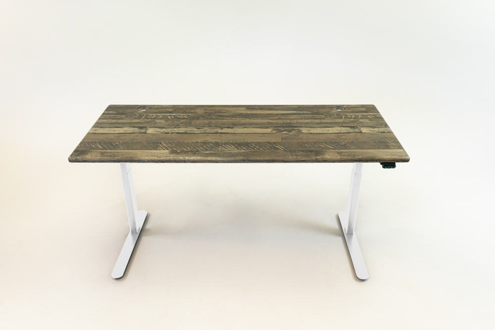 A Reclaimed Warehouse Oak desktop on a white base.