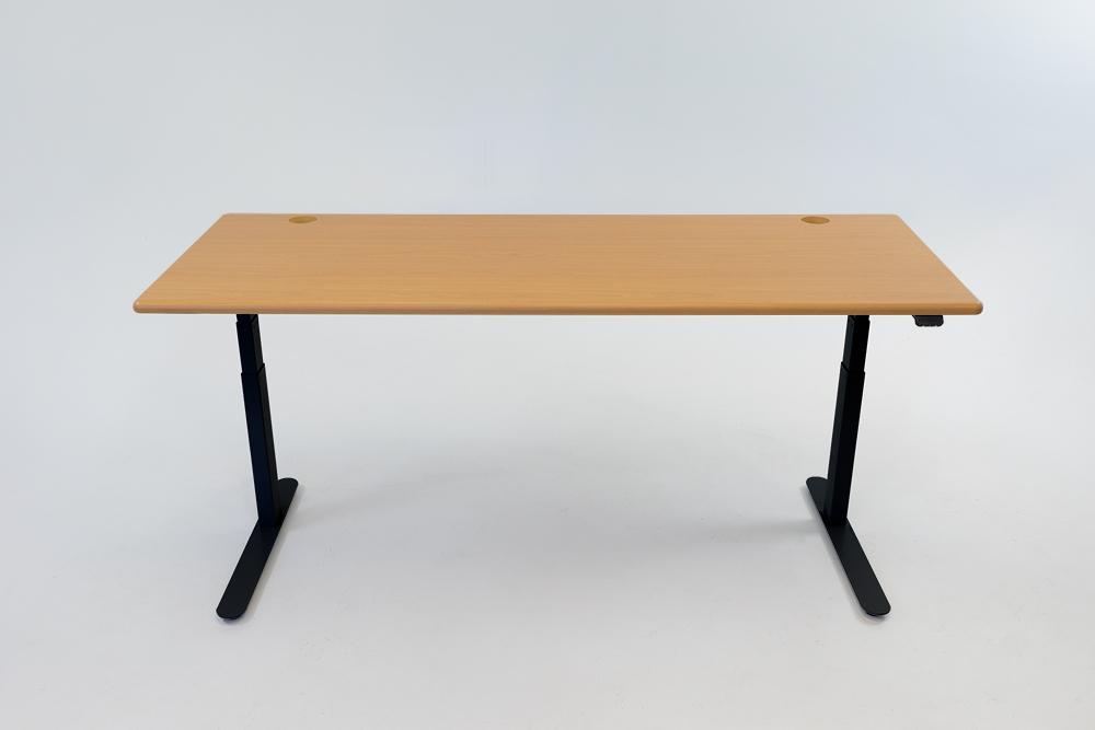 An Almond Cherry desktop on a black base.