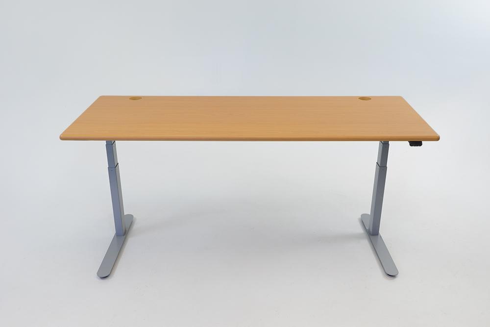 An Almond Cherry desktop on a silver base.