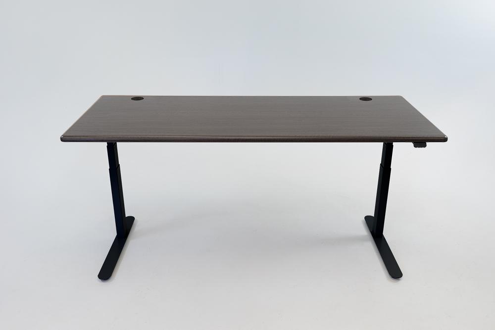 A Obsidian Oak desktop on a black base.