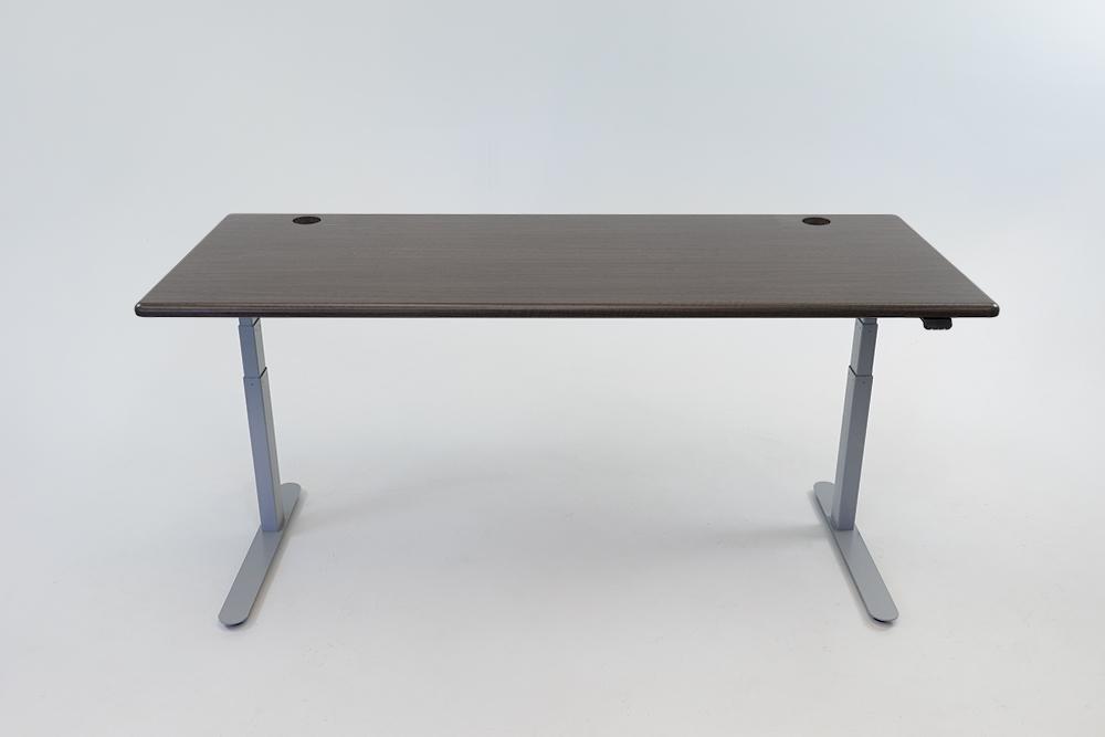 A Obsidian Oak desktop on a silver base.
