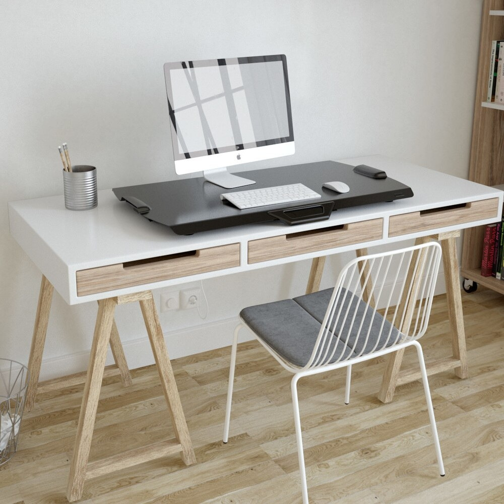 iMovR+Eureka Ultra-Slim Portable Sit-Stand Desk Converter in a lowered position on a wooden desk.