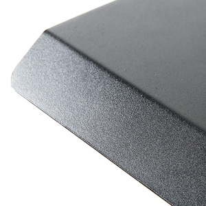 The iMovR+Eureka Ultra-Slim Portable Sit-Stand Converter's durable textured surface and ergonomically inclined edge.