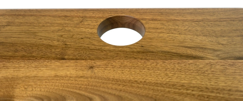 Add grommet holes to your solid wood desk.