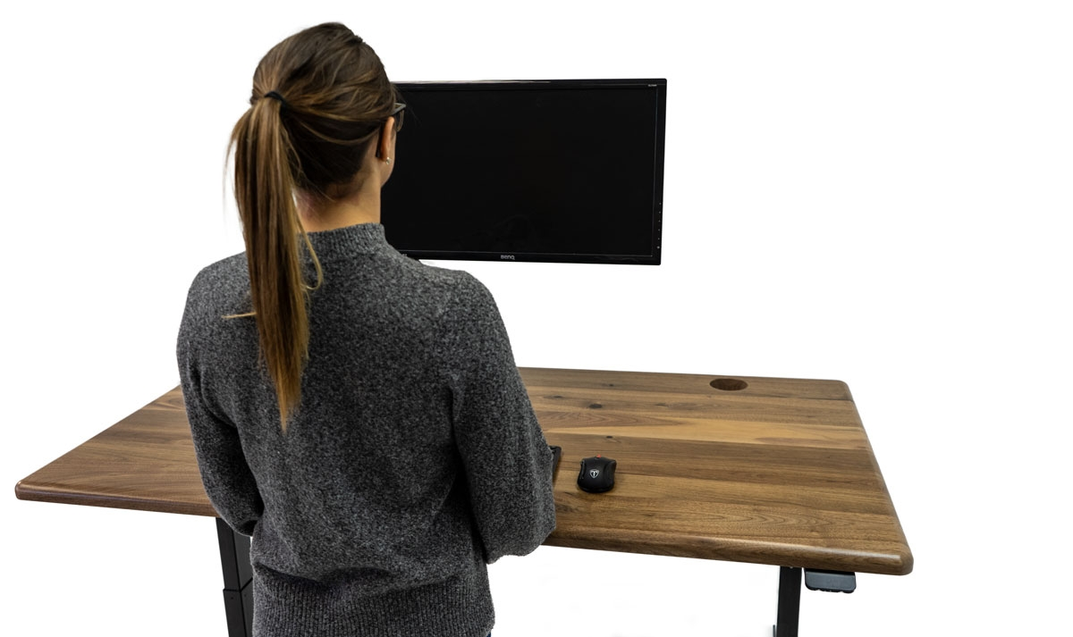 Working at a Solid Wood Lander Desk in Natural Rustic Walnut