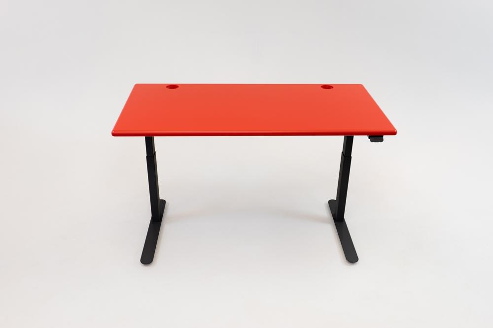A Racing Red desktop on a black base.