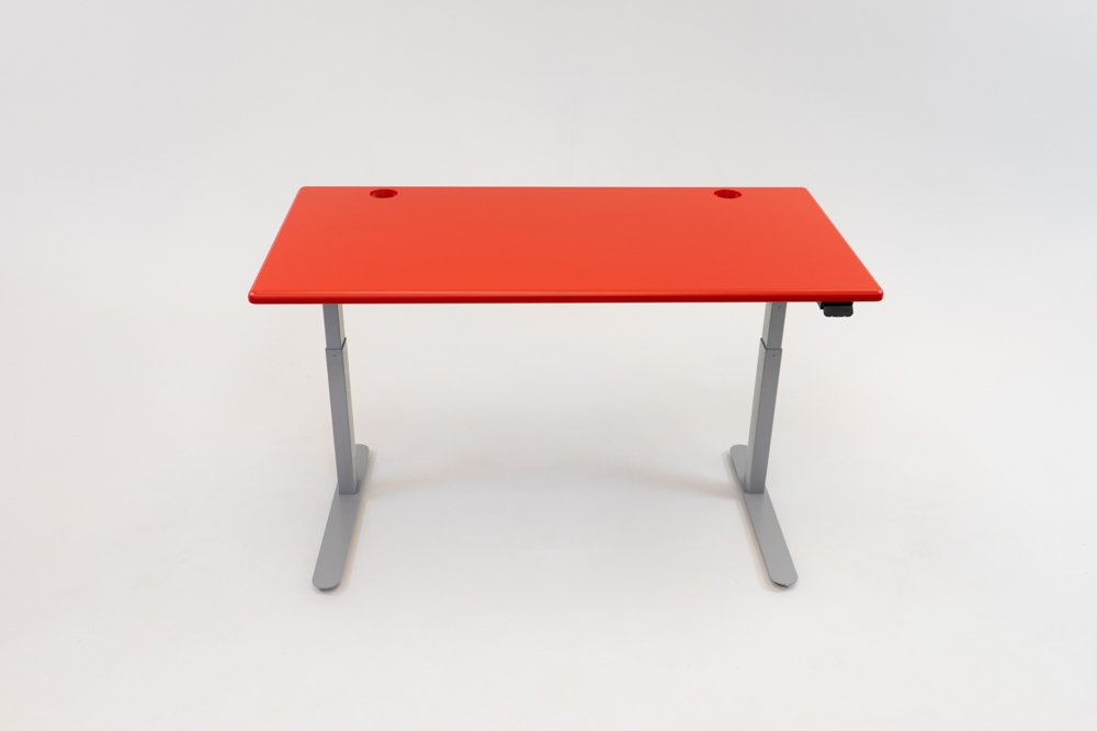 A Racing Red desktop on a silver base.