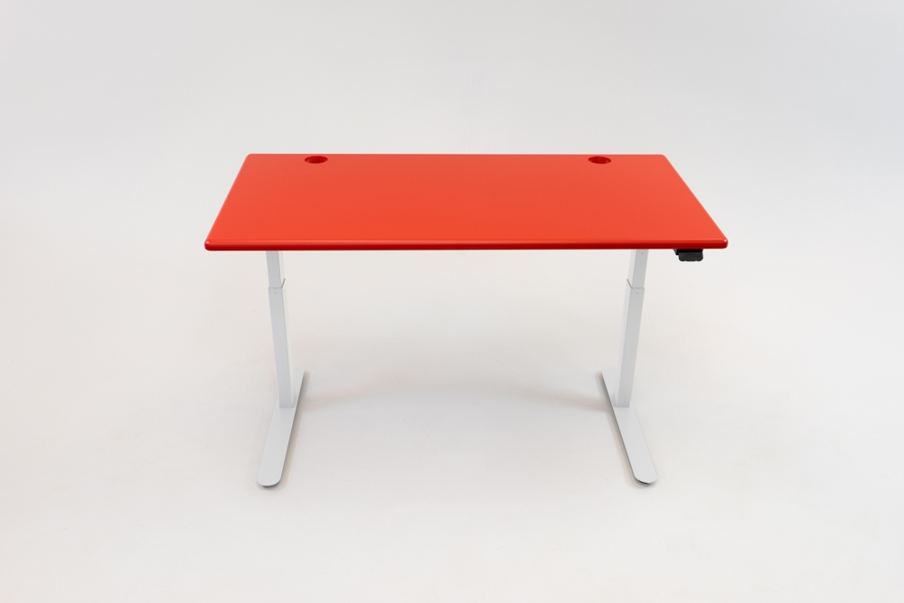 A Racing Red desktop on a white base.