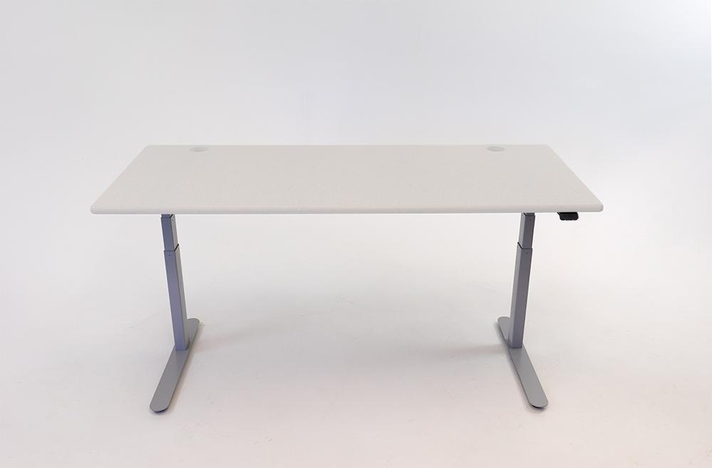 A Fibers Concrete desktop on a silver base.