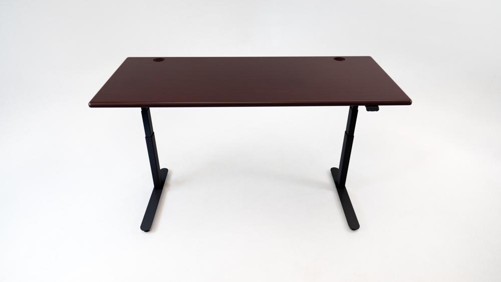 A Clove Mahogany desktop on a black base.